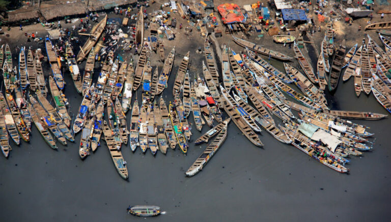 An aerial photograph of fishing boats in Accra Point, Ghana