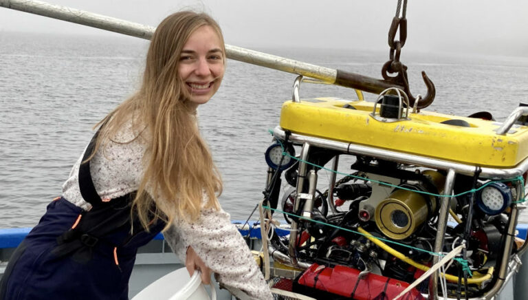 One Ocean Hub researcher Kelsey Archer Barnhill on a boat.